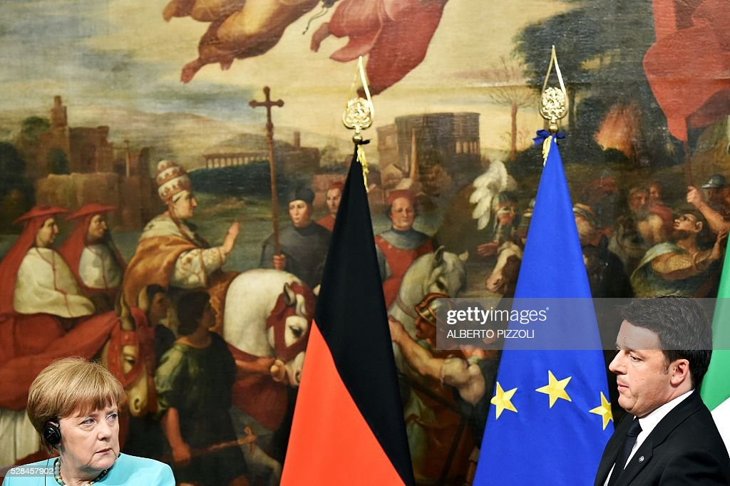 German Chancellor Angela Merkel (L) during a news conference together with Italian Prime Minister Matteo Renzi (R) after their meeting in Rome's Palazzo Chigi on May 5, 2016. EU president Donald Tusk travels to Rome Thursday with fellow EU institution leaders and German Chancellor Angela Merkel for two days of talks likely to focus on next steps in Europe's migrant crisis. Prime Minister Matteo Renzi, who fears Italy becoming the new migrant frontline after the closure of the Balkan route, will host the first day of talks, followed by Pope Francis on Friday. PIZZOLI