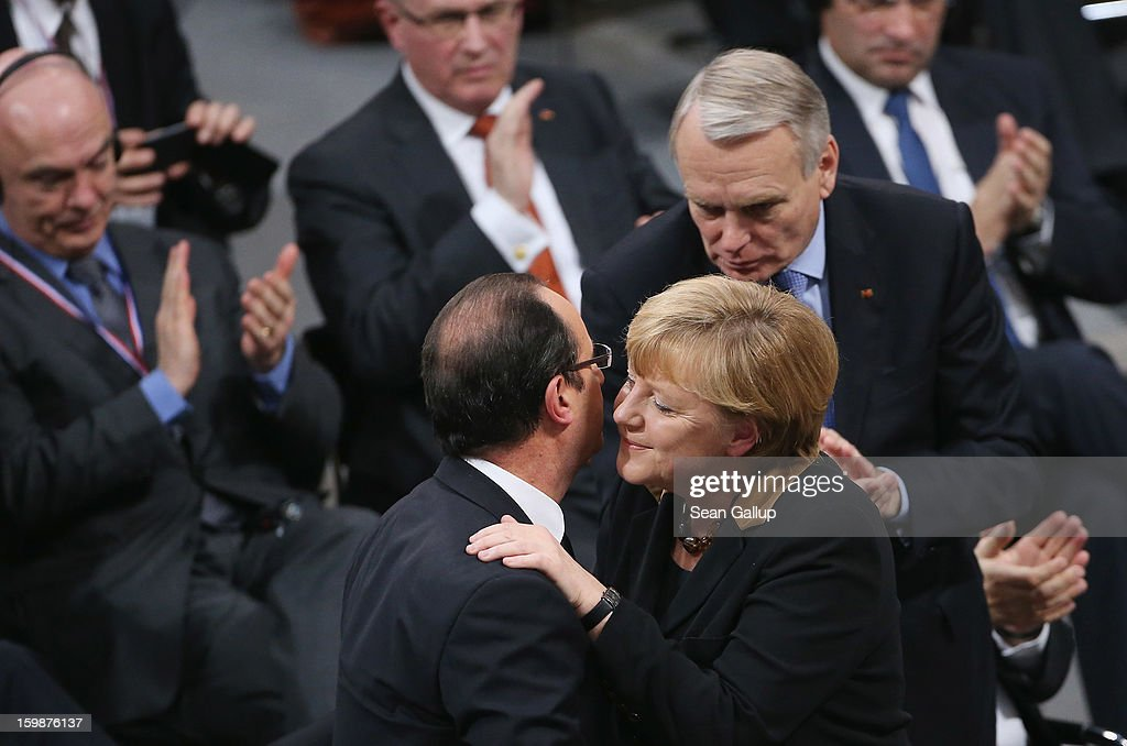 German Chancellor Angela Merkel embraces French President Francois Hollande after she spoke to members of the German Bundestag and French Assemblee Nationale during a joint session of the two governments at the Bundestag during the 50th anniversary celebration of the Elysee Treaty on January 22, 2013 in Berlin, Germany. The treaty, concluded in 1963 by Charles de Gaulle and Konrad Adenauer in the Elysee Palace in Paris, set a new tone of reconciliation between France and Germany, and called for consultations between the two countries to come to a common stance on policies affecting the most important partners in Europe as well as the rest of the region. Since its establishment, the document for improved bilateral relations has been seen by many as the driving force behind European integration.