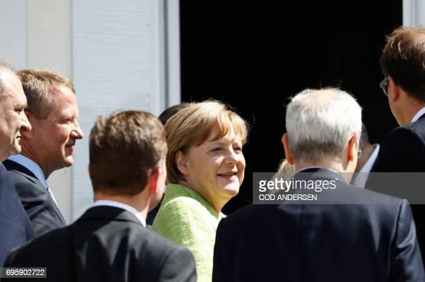 German Chancellor Angela Merkel enters the Meseberg Palace during 'Future Talks' meeting with social partners on June 14 2017 near Berlin PHOTO / Odd...