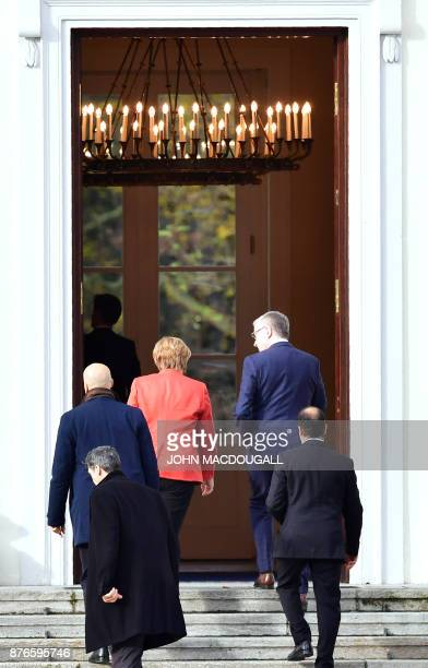 German Chancellor Angela Merkel enters the presidential residence Bellevue Castle in Berlin to meet the German President on November 20 2017 after...