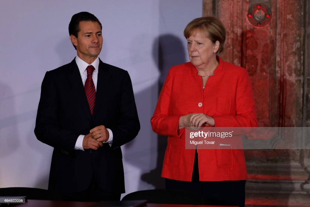 German Chancellor Angela Merkel enters to the Economic Museum with Mexican President Enrique Peña Nieto during a meeting with businessmen as part of an official visit of German Chancellor Angela Merkel to Mexico at MIDE (Interactive Economic Museum) on June 10, 2017 in Mexico City, Mexico.
