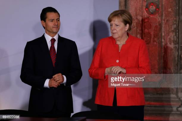 German Chancellor Angela Merkel enters to the Economic Museum with Mexican President Enrique Peña Nieto during a meeting with businessmen as part of...
