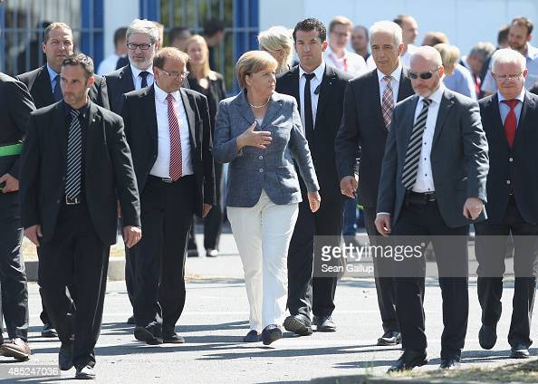 German Chancellor Angela Merkel flanked by Heidenau Mayor Juergen Opitz and Saxony Governor Stanislaw Tillich arrives to speak to the media after...