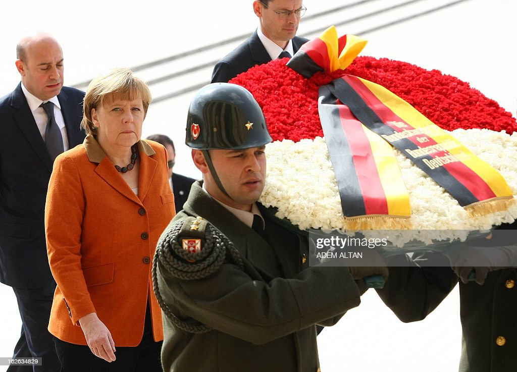 German Chancellor Angela Merkel (2ndL) follows an honour guard as she visits the mausoleum of Turkey's Republic's founder Kemal Ataturk in Ankara, on February 25, 2013, on the second an final day of her official visit to Turkey.