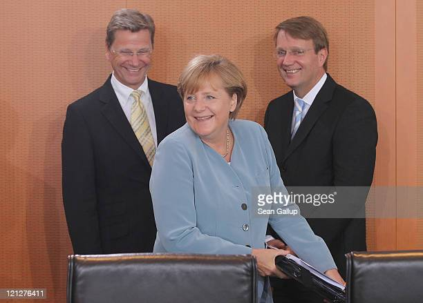 German Chancellor Angela Merkel Foreign Minister Guido Westerwelle and Minister of the Chancellery Ronald Pofalla arrive for the weekly German...