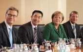 German Chancellor Angela Merkel Foreign Minister Guido Westerwelle Vice Chancellor and Economy Minister Philipp Roesler and Minister of the...