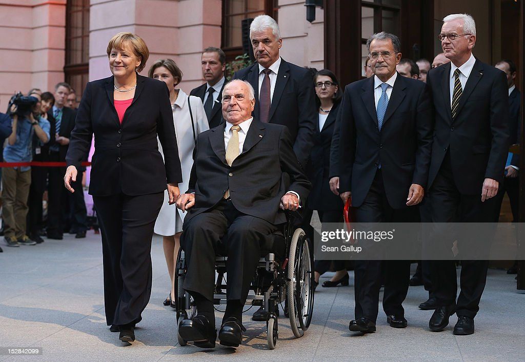German Chancellor <a gi-track='captionPersonalityLinkClicked' href=/galleries/search?phrase=Angela+Merkel&family=editorial&specificpeople=202161 ng-click='$event.stopPropagation()'>Angela Merkel</a> (L), former Italian Prime Minister <a gi-track='captionPersonalityLinkClicked' href=/galleries/search?phrase=Romano+Prodi&family=editorial&specificpeople=203301 ng-click='$event.stopPropagation()'>Romano Prodi</a> (2nd from R) and European Parliament President Hans-Gert Pottering (R) accompany former German Chancellor <a gi-track='captionPersonalityLinkClicked' href=/galleries/search?phrase=Helmut+Kohl&family=editorial&specificpeople=202518 ng-click='$event.stopPropagation()'>Helmut Kohl</a> at his arrival at a gala evening in his honour at the Deutsches Museum on September 27, 2012 in Berlin, Germany. Guests from politics, church and society attended the event to honour Kohl on the 30th anniversary of Kohl becoming chancellor. During his chancellorship Kohl facillitated the end of the Cold War, the fall of the Berlin Wall and German reunification.