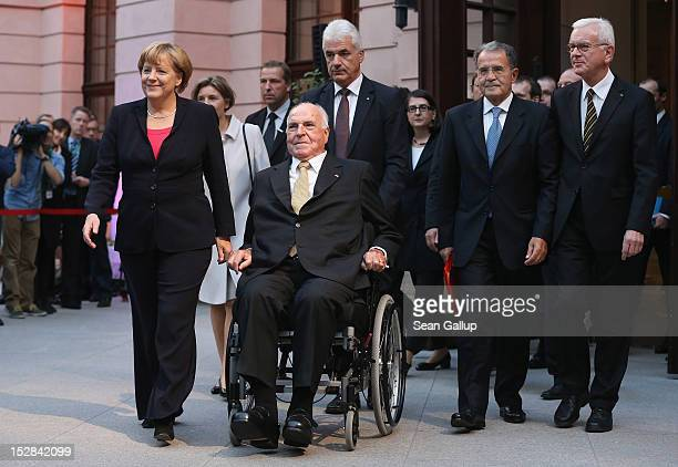 German Chancellor Angela Merkel former Italian Prime Minister Romano Prodi and European Parliament President HansGert Pottering accompany former...