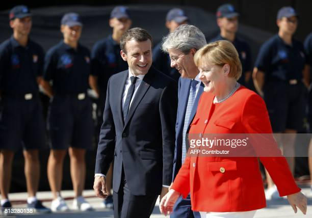 German Chancellor Angela Merkel French President Emmanuel Macron and Italy's Prime Minister Paolo Gentiloni share a light moment as they leave at the...