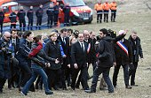 German Chancellor Angela Merkel French President Francois Hollande and Spanish Prime Minister Mariano Rajoy arrive on March 25 2015 in a field to pay...