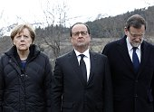 German Chancellor Angela Merkel French President Francois Hollande and Spanish Prime Minister Mariano Rajoy pay their respect to the victims in...