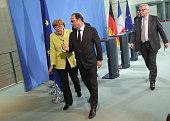 German Chancellor Angela Merkel French President Francois Hollande and European Union Commission President JeanClaude Juncker depart after giving...