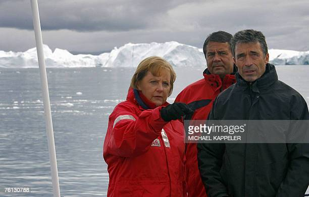 German Chancellor Angela Merkel German Environment Minister Sigmar Gabriel and Denmark's Prime Minister Anders Fogh Rasmussen are pictured 16 August...