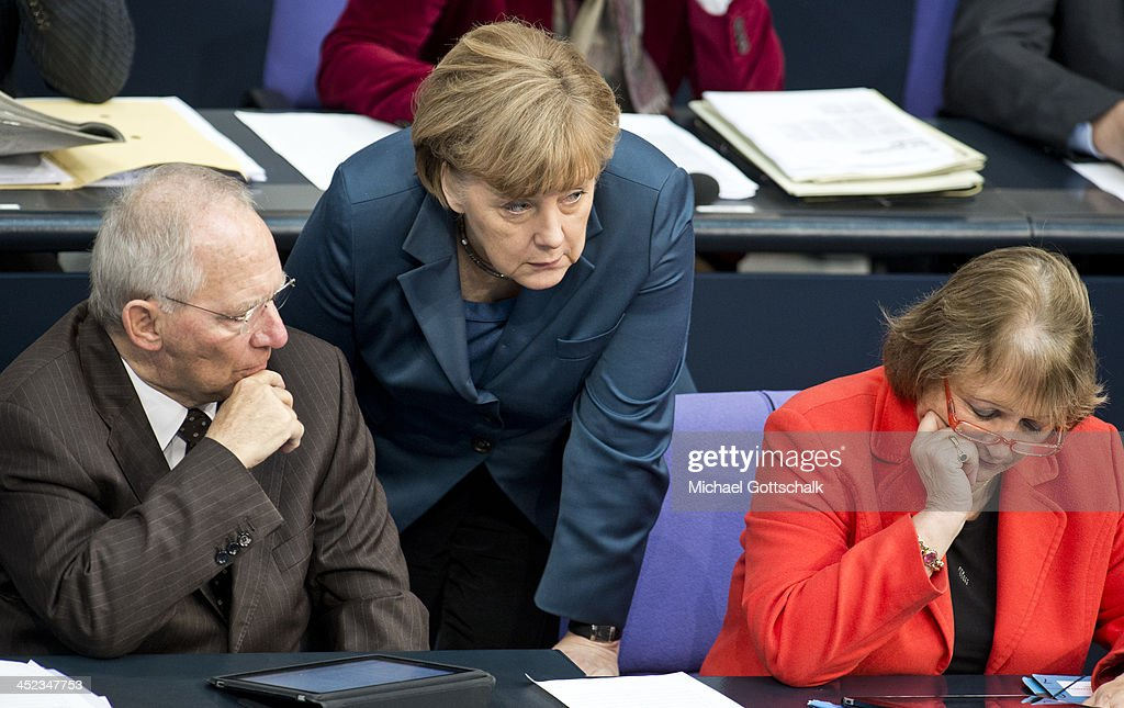 German Chancellor Angela Merkel, German Finance Minister Wolfgang Schaeuble, and German Justice Minister Sabine Leutheusser-Schnarrenberger, attend a plenary session in German Bundestag on November 28, 2013 in Berlin, Germany. The Bundestag debates the extensions of Bundeswehr mission in South-Sudan.