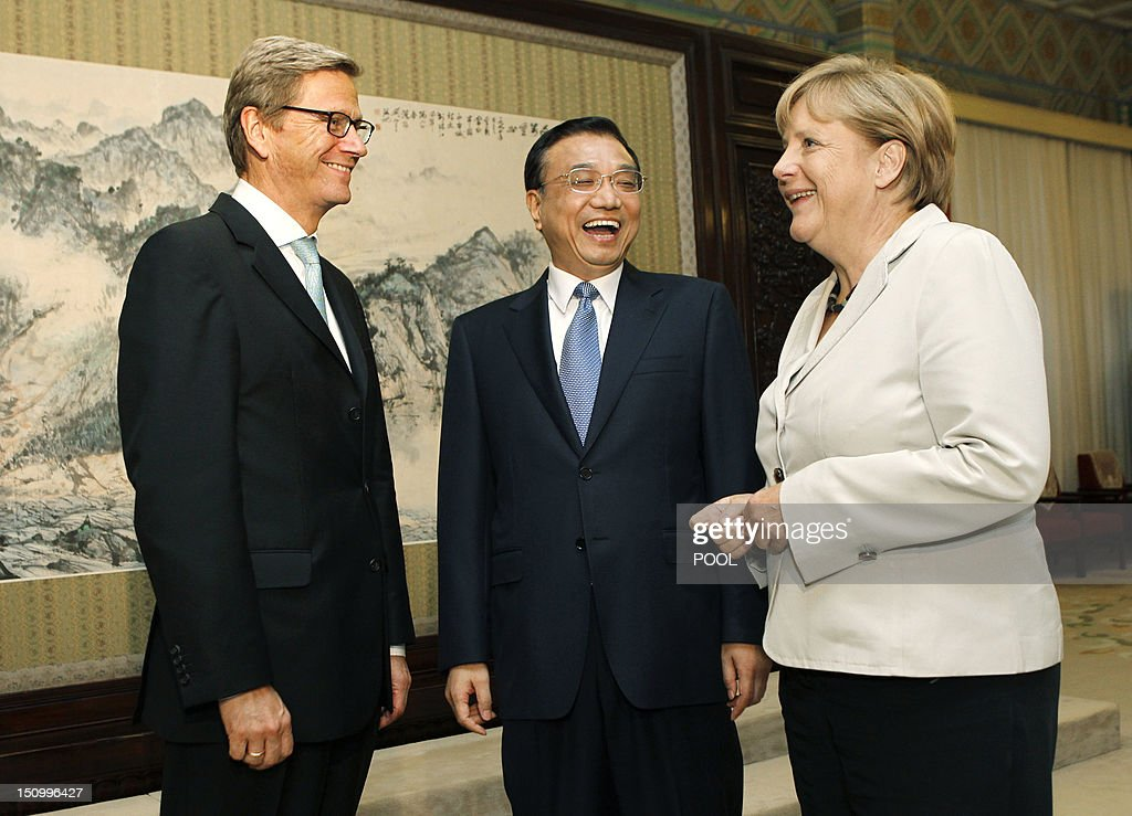 German Chancellor Angela Merkel (C), German Foreign Minister Guido Westerwelle (L) and Chinese Vice-Premier Li Keqiang share a light moment during their meeting at the Zhongnanhai diplomatic compound in Beijing on August 30, 2012. German leader Angela Merkel is holding top-level talks on her second visit to China this year, with Europe's debt crisis taking centre stage as it begins to drag on the two global powers. Leading several ministers and a high-powered business delegation, Merkel will meet Premier Wen Jiabao in Beijing during the two-day trip and travel to an assembly plant of European planemaker Airbus in nearby Tianjin city.