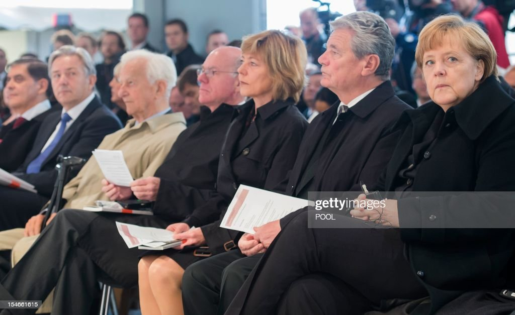 German Chancellor Angela Merkel, German President Joachim Gauck, his partner Daniela Schadt, President of the Bundestag (lower house of parliament) Norbert Lammert, former German President Richard von Weizsaecker, Berlin mayor Klaus Wowereit and Romani Rose, chairman of the Central Council of Sinti and Roma in Germany, attend festivities to inaugurate a memorial to the estimated half million Roma and Sinti murdered by the Nazis, on October 24, 2012 in Berlin. The long-delayed monument, consisting of a round pool of water and stele on which a single fresh flower will rest each day, sits opposite the Reichstag parliament building in central Berlin. AFP PHOTO / POOL / CLEMENS BILAN