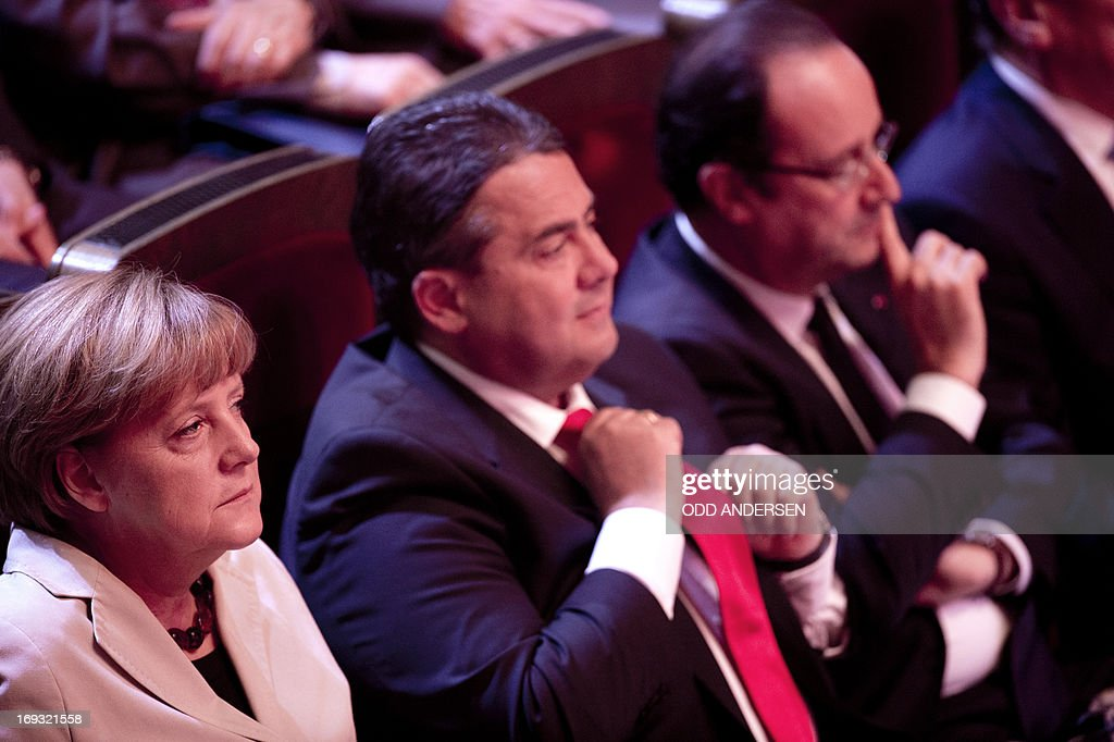 German Chancellor Angela Merkel, German Social Democratic Party (SPD) leader Sigmar Gabriel and French President Francois Hollande are pictured at the Gewandhaus concert hall in Leipzig, eastern Germany as they attend festivities to mark the SPD's 150th anniversary on May 23, 2013. The SPD, Europe's oldest political party, has invited nearly 50 current and former heads of state and government as it celebrates 150th birthday and its turbulent history, which saw it advance workers rights and suffer persecution by the Nazis. The SPD was founded on May 23, 1863 in Leipzig as the 'Allgemeiner Deutscher Arbeiterverein' (common German worker's club). AFP PHOTO / POOL / ODD ANDERSEN
