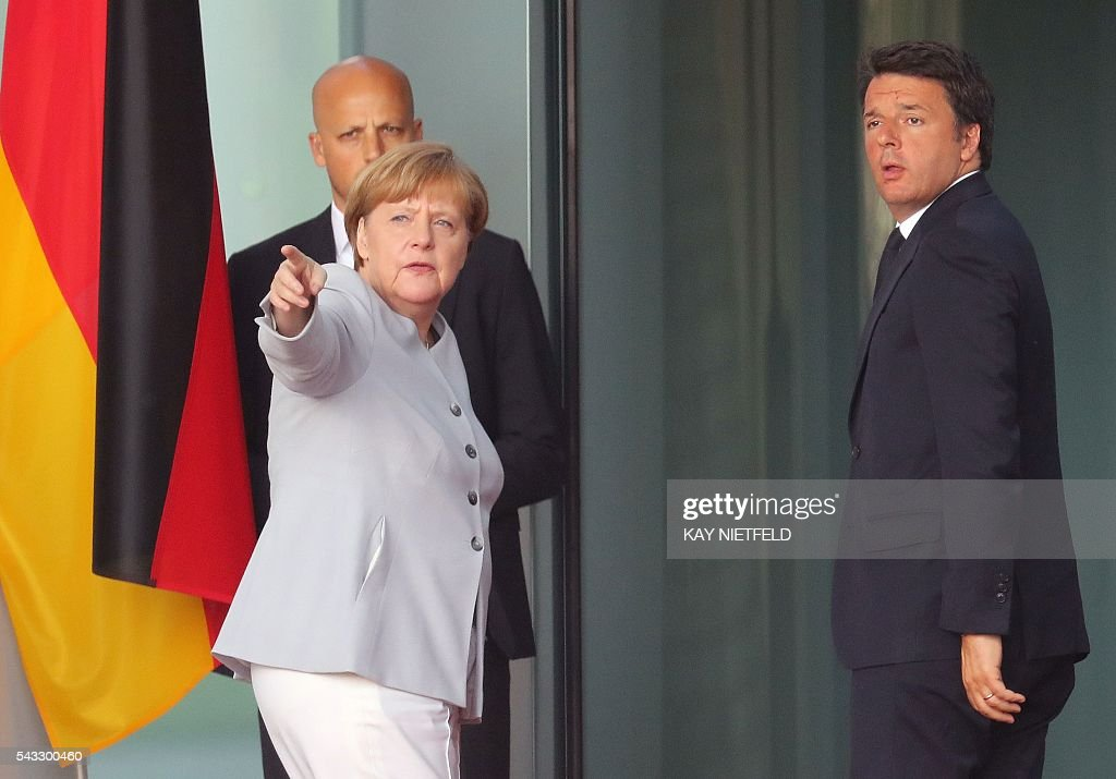German Chancellor Angela Merkel gestures as Italy's Prime Minister Matteo Renzi (R) arrives for talks following the Brexit referendum at the chancellery in Berlin, on June 27, 2016. Britain's shock decision to leave the EU forces German Chancellor Angela Merkel into the spotlight to save the bloc, but true to her reputation for prudence, she said she would act neither hastily nor nastily. / AFP / dpa / Kay Nietfeld / Germany OUT