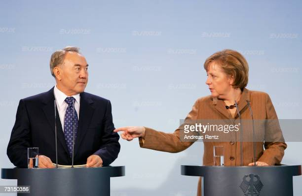German Chancellor Angela Merkel gestures as Kazakh President Nursultan Nazarbayev listens during a news conference at the Chancellery on January 30...