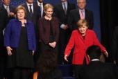 German Chancellor Angela Merkel gestures as Norwegian Prime Minister Erna Solberg and Danish Prime Minister Helle ThorningSchmidt look on at the...