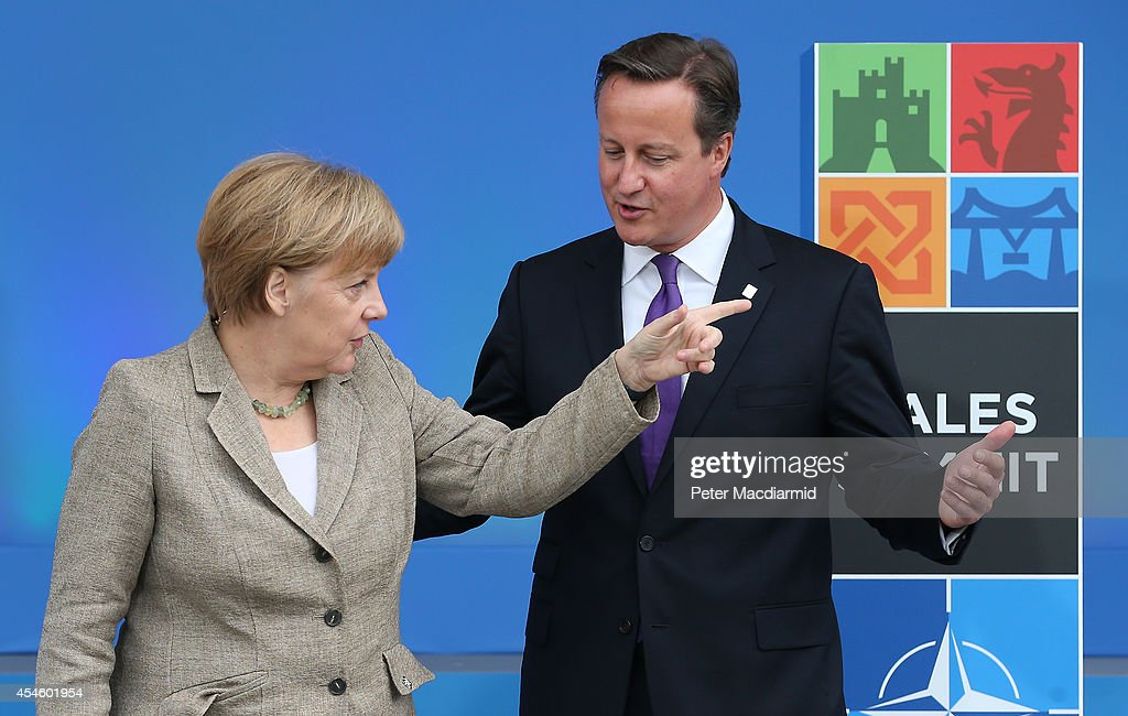German Chancellor Angela Merkel gestures as she meets with British Prime Minister David Cameron at the NATO Summit on September 4 2014 in Newport...