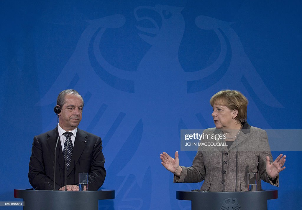 German Chancellor Angela Merkel (R) gestures as she speaks during a press conference with Malta's Prime Minister Lawrence Gonzi , following talks at the chancellery in Berlin, Germany on January 9, 2013. AFP PHOTO / JOHN MACDOUGALL