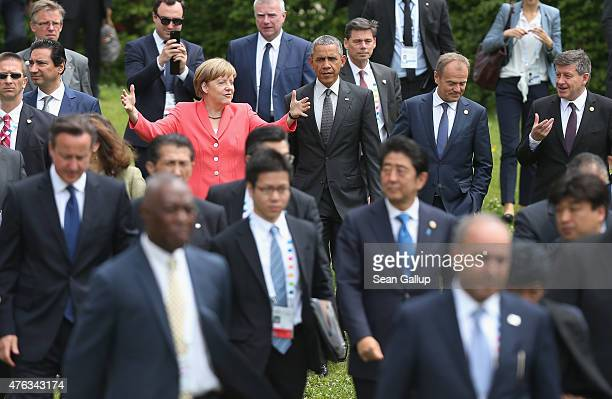 German Chancellor Angela Merkel gestures as she US President Barack Obama G7 nation leaders European Union leaders and Outreach program nation...