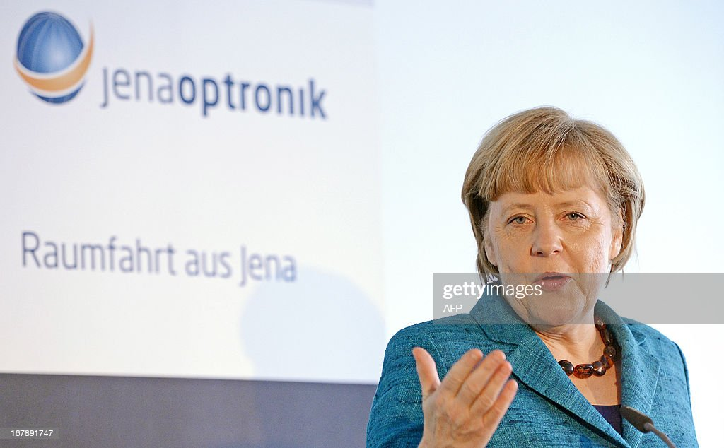 German Chancellor Angela Merkel gestures during her visit of Jena-Optronik GmbH (Ltd), a provider of opto-electronic instruments and sub-systems for space applications, on May 2 , 2013 in Jena, eastern Germany.