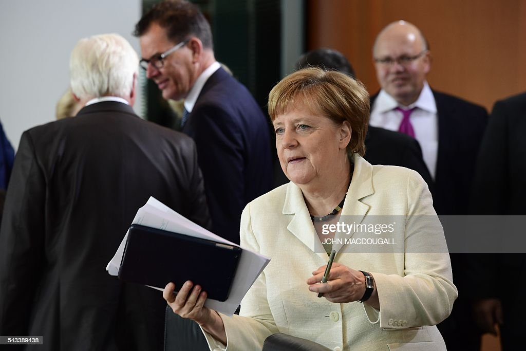 German Chancellor Angela Merkel gestures upon arrival at German govermnent cabinet meeting at the chancellery in Berlin on June 28, 2016. / AFP / John MACDOUGALL