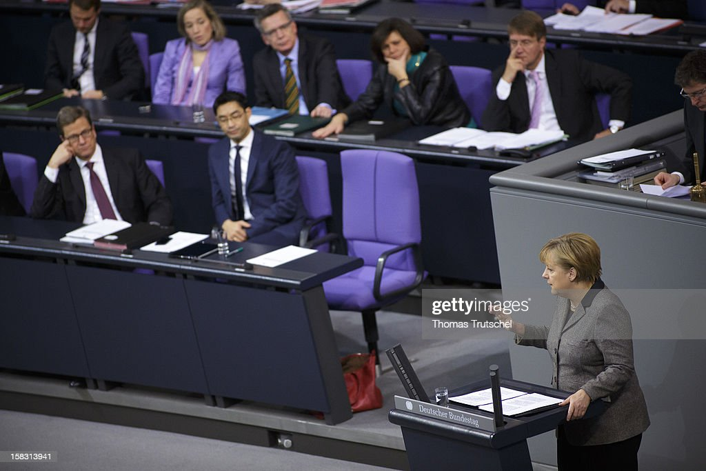 German Chancellor <a gi-track='captionPersonalityLinkClicked' href=/galleries/search?phrase=Angela+Merkel&family=editorial&specificpeople=202161 ng-click='$event.stopPropagation()'>Angela Merkel</a> gives a government declaration at Reichstag, the seat of the German Parliament (Bundestag) on December 13, 2012 in Berlin, Germany. Main Topic of her speech was the position Germany will take on the upcoming European Council meeting.