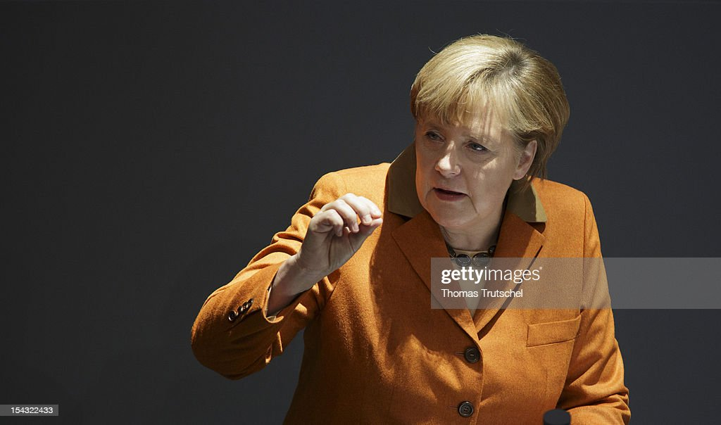 German chancellor <a gi-track='captionPersonalityLinkClicked' href=/galleries/search?phrase=Angela+Merkel&family=editorial&specificpeople=202161 ng-click='$event.stopPropagation()'>Angela Merkel</a> gives a government declaration on the European Council at Reichstag, the seat of the German Parliament (Bundestag), on October 18, 2012 in Berlin, Germany.
