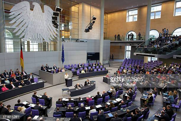 German Chancellor Angela Merkel gives a government declaration on the annual G8 leaders summit on European Council meeting at the Reichstag the seat...