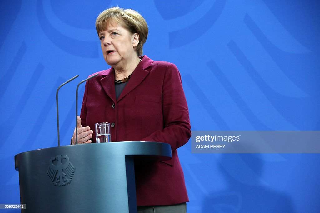 German Chancellor Angela Merkel gives a joint press conference with the Iraqi Prime Minister at the Chancellery in Berlin on February 11, 2016. / AFP / Adam BERRY