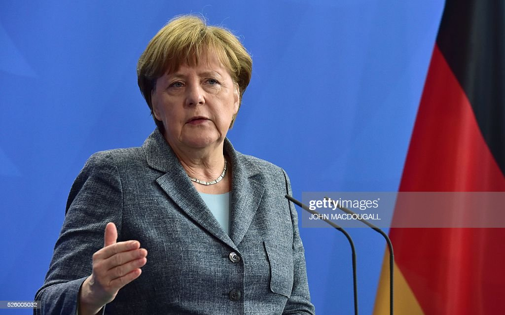 German Chancellor Angela Merkel gives a joint press conference with the Latvian Prime Minister (unseen) on April 29, 2016 at the Chancellery in Berlin. / AFP / John MACDOUGALL