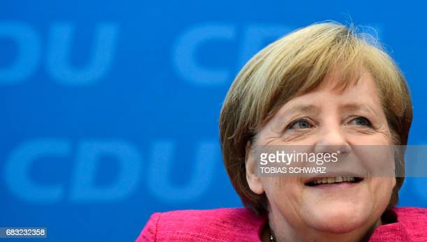 German Chancellor Angela Merkel gives a press conference at the headquarters of her conservative Christian Democratic Union party in Berlin on May 15...