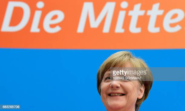 German Chancellor Angela Merkel gives a press conference at the headquarters of the CDU in Berlin on May 15 one day after regional elections in the...
