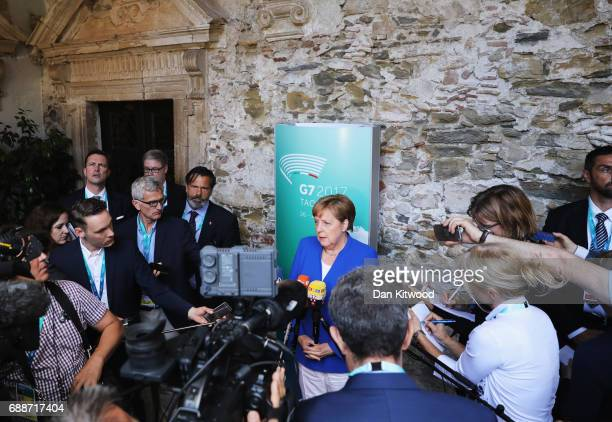 German Chancellor Angela Merkel gives a press conference at the San Domenico Palace Hotel while attending the G7 summit on May 26 2017 in Taormina...