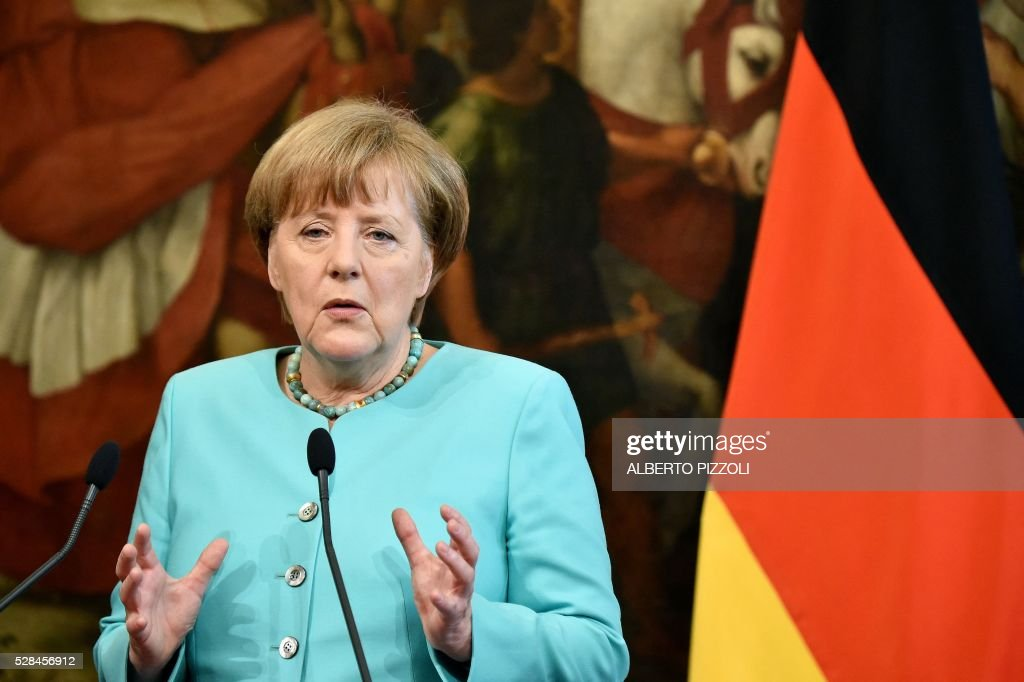 German Chancellor Angela Merkel gives a press conference together with Italian Prime Minister in Rome's Palazzo Chigi on May 5, 2016. EU president Donald Tusk travels to Rome Thursday with fellow EU institution leaders and German Chancellor Angela Merkel for two days of talks likely to focus on next steps in Europe's migrant crisis. Prime Minister Matteo Renzi, who fears Italy becoming the new migrant frontline after the closure of the Balkan route, will host the first day of talks, followed by Pope Francis on Friday. PIZZOLI