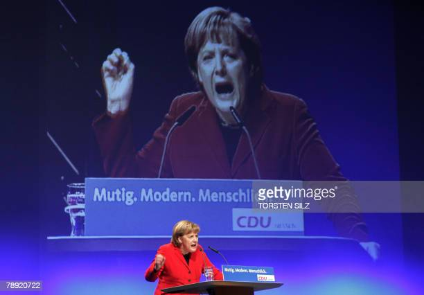 German Chancellor Angela Merkel gives a speech 13 January 2008 in Wetzlar western Germany during an electoral meeting for the upcoming state...