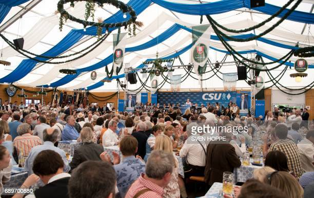 German Chancellor Angela Merkel gives a speech as she attends an election campaign event of the Christian Social Union Bavarian sister party of her...