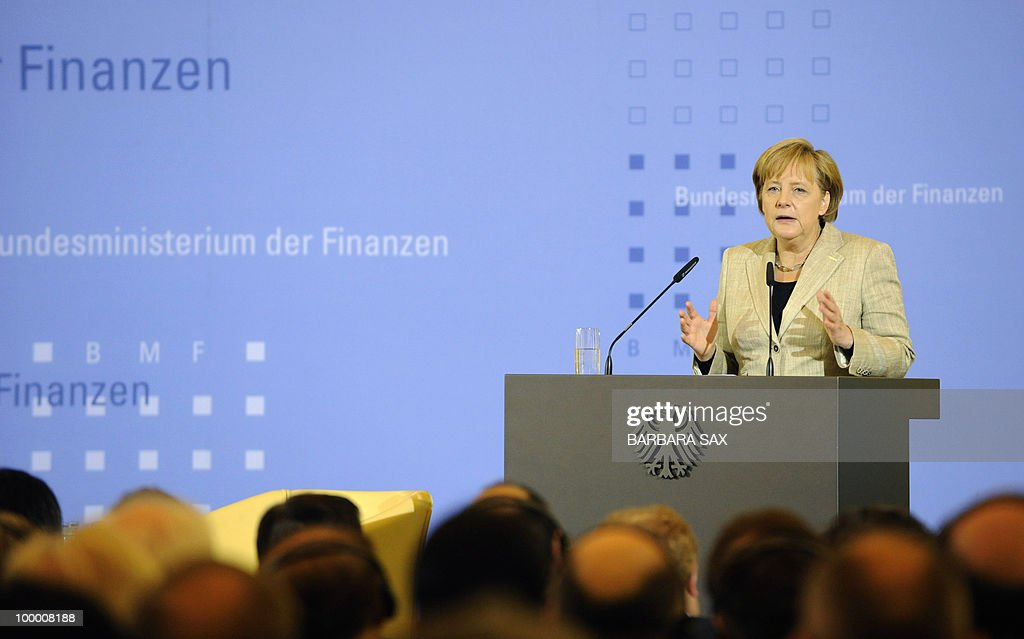 German Chancellor Angela Merkel gives a