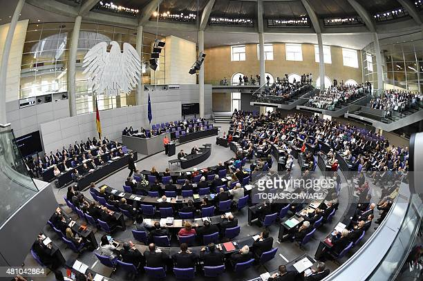 German Chancellor Angela Merkel gives a speech during a special session at the Bundestag in Berlin on July 17 2015 German lawmakers rally to vote on...