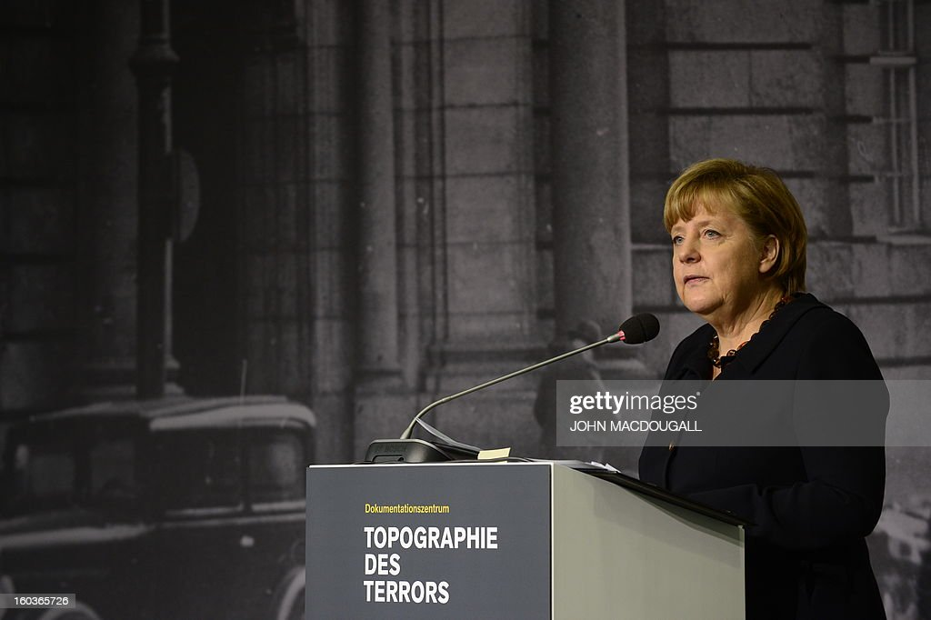German Chancellor Angela Merkel gives a speech to inaugurat the exhibition 'Berlin 1933 On the Path to Dictatorship', tracing Adolf Hitler's rise to power in Germany in 1933 to mark 80 years since he became chancellor, on January 30, 2013 at the open-air documentation center Topographie des Terrors in Berlin. The exhibition located at the former headquarters of the Gestapo, the secret police of the Nazi regime, traces Hitler's first months in power through photos, newspapers and posters. MACDOUGALL