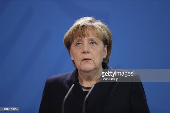 German Chancellor Angela Merkel gives a statement the day after a man drove a truck into a crowded Christmas market on December 20 2016 in Berlin...