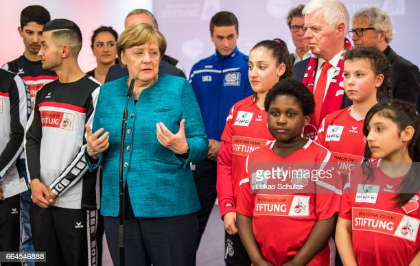German Chancellor Angela Merkel gives an interview after a meeting with members of the 1 FC Koeln Foundation and members of the initiative 'Wir...