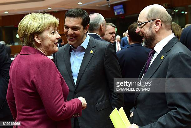 German Chancellor Angela Merkel Greek Prime Minister Alexis Tsipras and European Parliament President Martin Schulz speak as they attend a European...