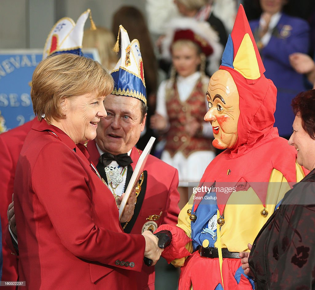 German Chancellor <a gi-track='captionPersonalityLinkClicked' href=/galleries/search?phrase=Angela+Merkel&family=editorial&specificpeople=202161 ng-click='$event.stopPropagation()'>Angela Merkel</a> greets a masked Carnival fool while meeting with Carnival delegates from all over Germany on January 29, 2013 in Berlin, Germany. Merkel received the delegates at an annual ceremony at the Chancellery. Germany is in the midst of Carnival season, which ends with its highpoint between Rose Monday and Ash Wednesday in a tradition common in several countries in Europe and the Americas.