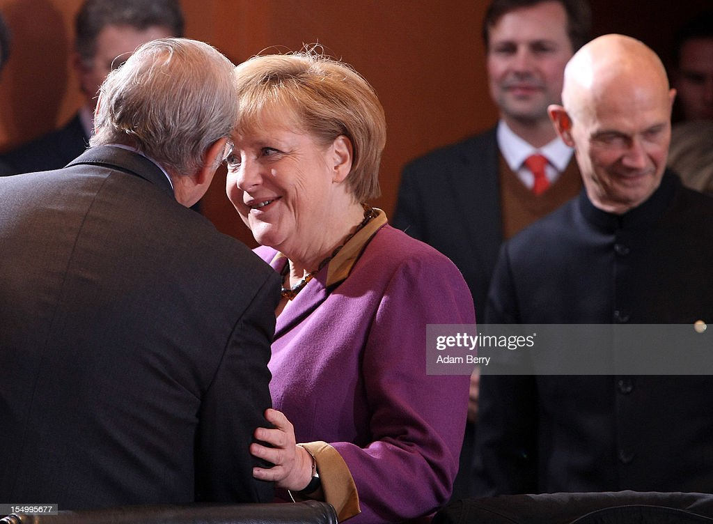 German Chancellor <a gi-track='captionPersonalityLinkClicked' href=/galleries/search?phrase=Angela+Merkel&family=editorial&specificpeople=202161 ng-click='$event.stopPropagation()'>Angela Merkel</a> greets Angel Gurria, secretary-general of the Organisation for Economic Co-operation and Development (L), next to <a gi-track='captionPersonalityLinkClicked' href=/galleries/search?phrase=Pascal+Lamy&family=editorial&specificpeople=220438 ng-click='$event.stopPropagation()'>Pascal Lamy</a>, director-general of the World Trade Organization (WTO), as they arrive for a meeting on October 30, 2012 at the German federal chancellery in Berlin, Germany. Merkel met with the heads of five international financial and economic bodies to discuss the global economic outlook as well as the situation in Europe in particular, concentrating on policies to improve competitiveness, trade and development.