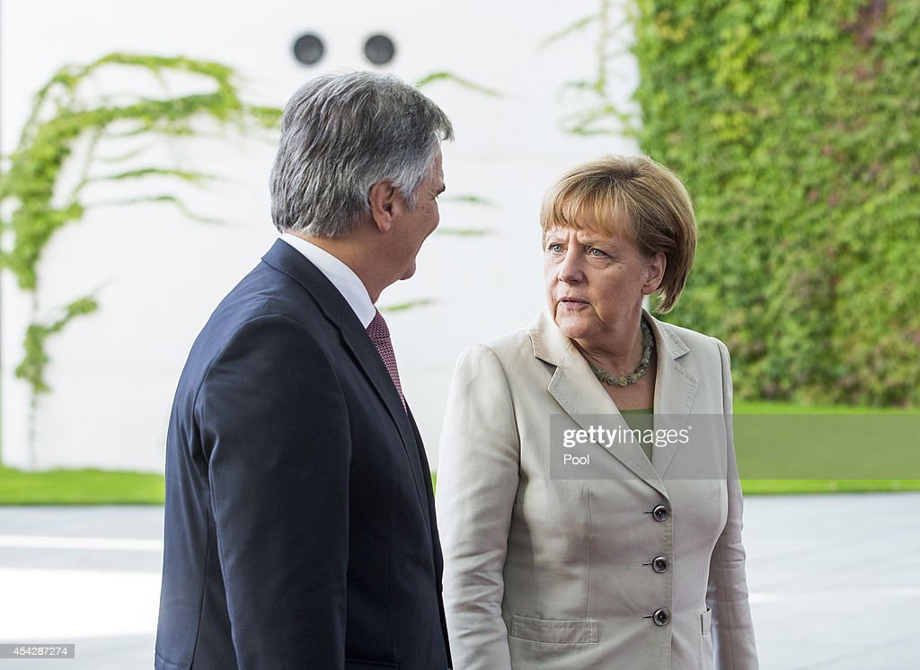 German Chancellor Angela Merkel greets Austrian Chancellor Werner Faymann upon his arrival for the German government Balkan conference at the...