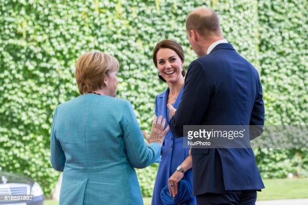 German Chancellor Angela Merkel greets Britain's Prince William Duke of Cambridge and his wife Kate the Duchess of Cambridge upon their arrival at...
